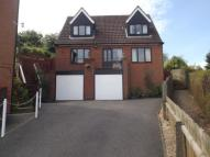 Detached house in Woodland Close...