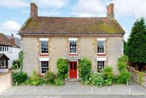 Detached house in High Street, Hanslope...