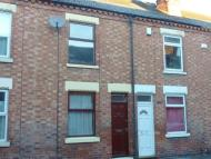 Terraced property in 123 Station Street...