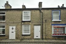 Terraced home to rent in High Street, Bollington...