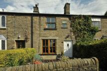 Terraced house in Moss Brow, Bollington...