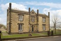 Detached home in 20 Huddersfield Road...