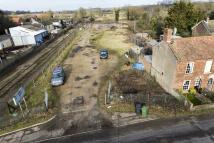 Land in Station Yard...