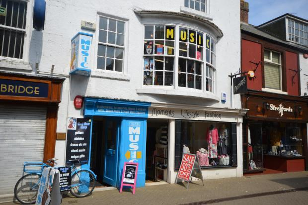 Commercial property for sale in music shop business for for Commercial house music