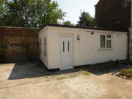 Studio flat in Cann Hall Road, London...