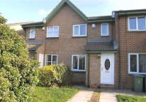 Terraced property in Crossfield Park...