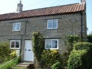 Terraced property in High Street, Wombleton...