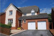 Detached property in Farm House Rise...