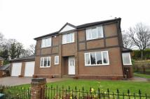 Detached property in Woodend Drive...