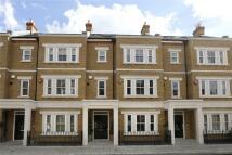 Terraced home in Warriner Gardens, London...