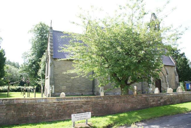 Wigginton Church next door