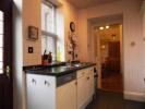 Kitchen to dining [property images]