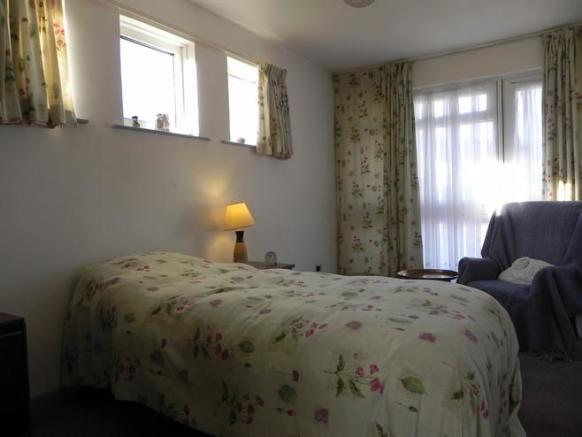Bed with door out (Property Image)