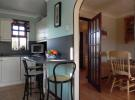 Kitchen showing dining [property images]
