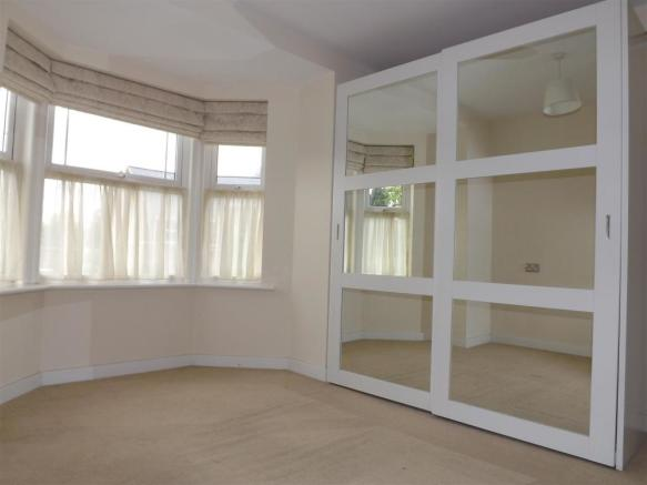 Bedroom with mirrored wardrobes