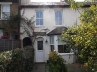 Terraced house in Park Square, Esher...