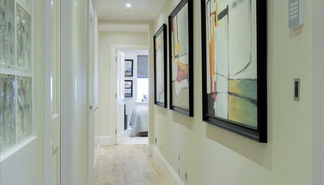 Hallway with wood flooring