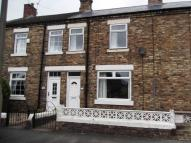 Terraced property in Baxters Place...