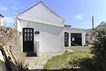 Detached property in High Street, Rhosneigr...