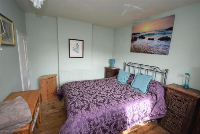 Purple bed bedroom - Copy.JPG