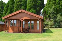 Chalet to rent in Trewidland