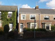 semi detached property in 50 Cemetery Road...
