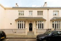 Terraced home in Park Village West...
