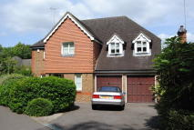 Detached house in Green Lane, Leatherhead