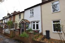 Terraced property in Grove Cottages...