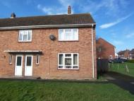 semi detached property in 22 Church Close...