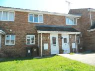 Terraced property in Pinewood Drive...