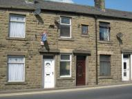 Terraced property in Market Street Whitworth.