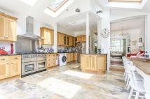 Terraced home for sale in Durnsford Avenue, SW19