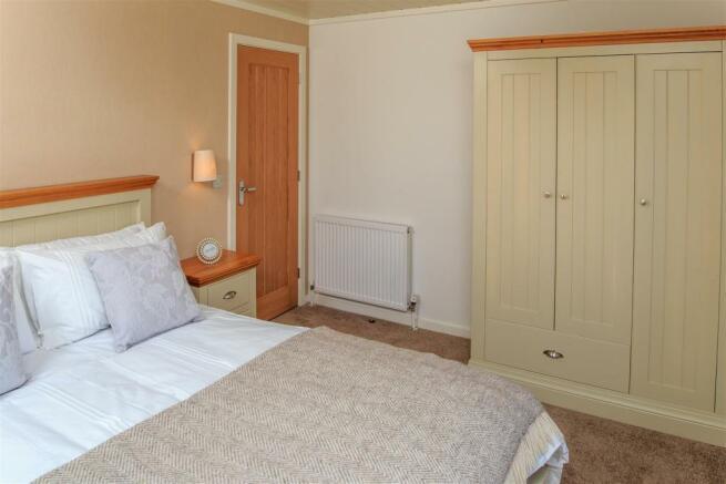 Sampool-Plantation-Lodges-30 Bedroom 2.jpg