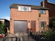 Detached home in Mold Road, Mynydd Isa