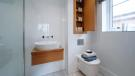 En suite Avant Homes full height tiling
