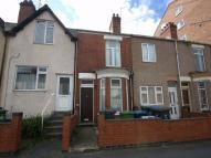 Terraced property in Market Street, RUGBY...