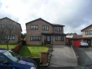 Detached property in Cemaes Road...