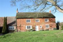 Detached home in Manor Farm Cottage...