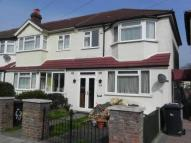 Terraced home in Woodmansterne Road...