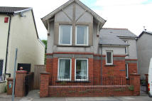 Detached home in Commercial Street...