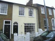 Terraced house to rent in Archway Street, Barnes...