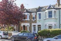 Terraced house in Cambridge Road, London...
