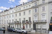 Flat in 11-12 Chesham Place...