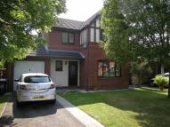 Detached property in Orchard Drive...