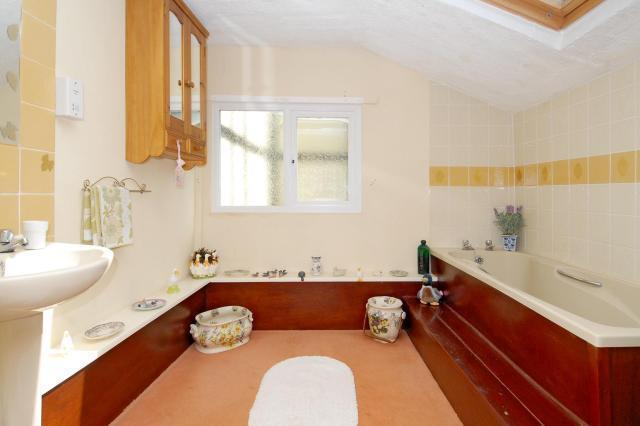 Bathroom with separate shower cubicle
