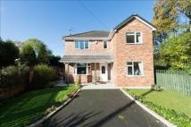 Detached property in 42 Chew Moor Lane...