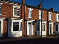 Terraced property in Station Road, Norton...