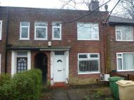 Terraced home in Moss Bank Way, Smithills...
