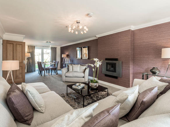 Spacious living / dining area with feature fire place